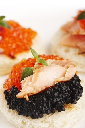 sea weed: Salmon roe, sea weed roe, smoked salmon and onion on the toasts Stock Photo