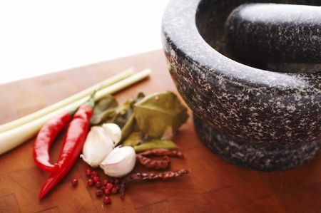 Mortar made from stone with chili, herbs and garlic