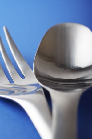close up of spoon and fork on the blue table