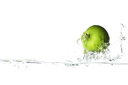 Isolated green apple surfing on the big wave