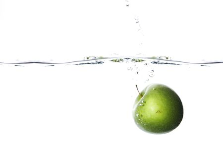 Apple dropped to water on white background