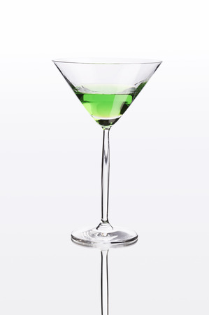 drunks: Green cocktail on white mirror like surface