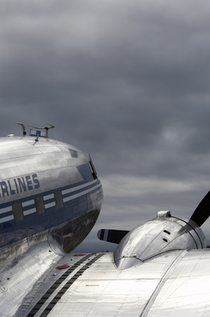 Old airplane  with blue toning against the sky.