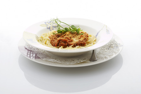Spaghetti bolognese plate on shiny white table at the restaurant Stock Photo - 1481462