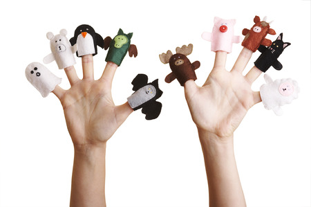 Isolated girl's hands with finger puppet (farm animals, ghost, penguin and dragon) Stock Photo - 1536331