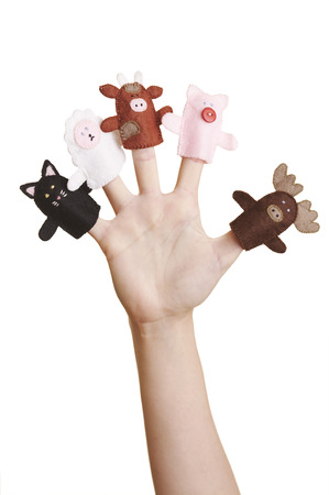 Girl's hand with animal finger puppets (cat, sheep, cow, pig and moose) Stock Photo - 1536301