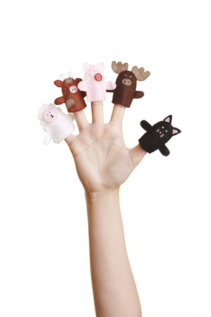 Girls hand with animal finger puppets (cat, sheep, cow, pig and moose) photo