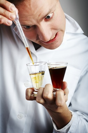 Mad scientist mixing a drink Stock Photo