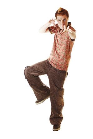 karate kick: Young man doing a karate kick Stock Photo