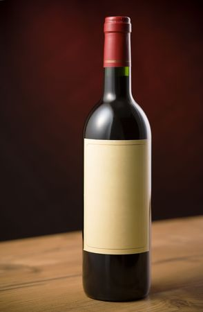 Red wine bottle on wooden table over dark red background Stock Photo - 2379812