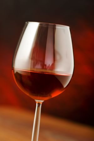 cabarnet: red wine glass over a dark background