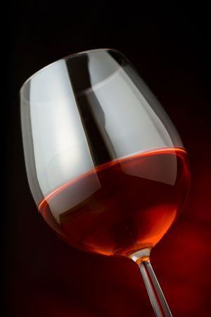 red wine glass over a dark background Stock Photo - 2412621