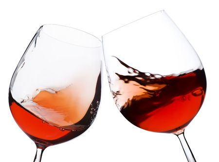 glass of red wine: pair of moving wine glasses over a white background, cheers!