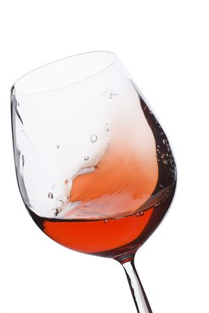 cabarnet: Isolated and moving red wine glass over a white background