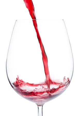 Pouring red wine into to the glass