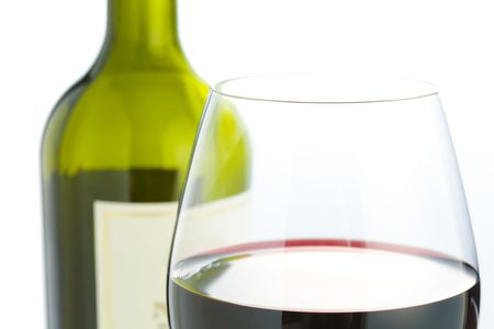 Close up of glass with red wine bottle on background Stock Photo - 2491894