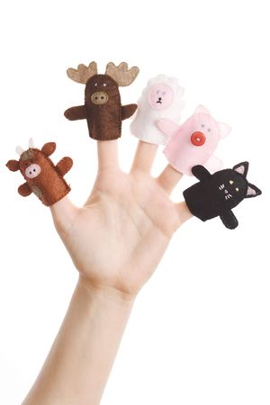 Girl wearing five finger puppets (pig, cat, cow, moose, lamb) Stock Photo