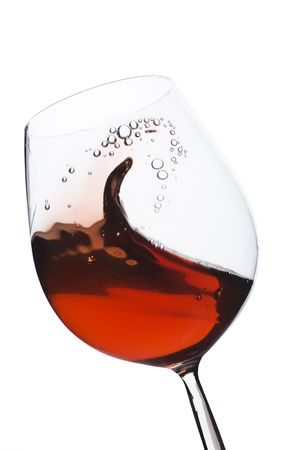 Isolated moving (motion blur) red wine glass over a white background Stock Photo - 2528360