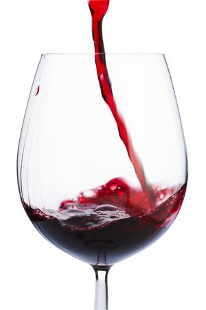badly: Badly poured red wine in the glass  Stock Photo
