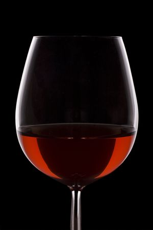 redwine: Isolated red wine glass over a black background