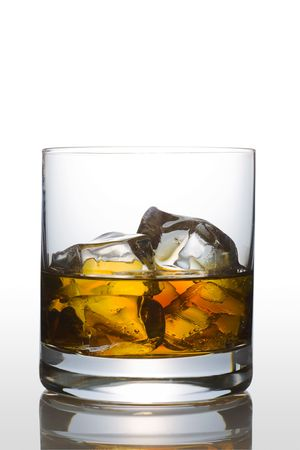 icecube: Front view of scotch glass on white background