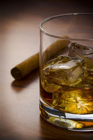 drunks: Whisky glass with havanna cigar on the table