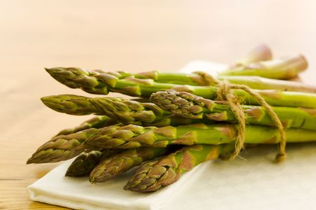 Pile of asparagus on the kitchen table Stock Photo