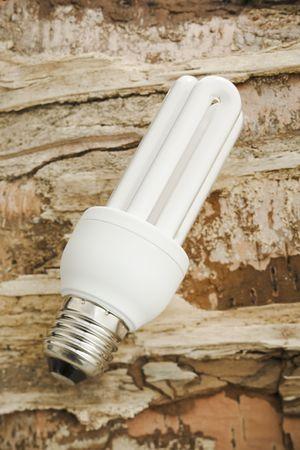 White fluorescent energy saver lamp over wood photo
