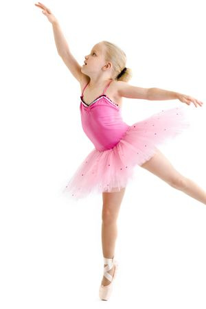 ballet child: Young ballerina standing on pointe in toe shoes Stock Photo