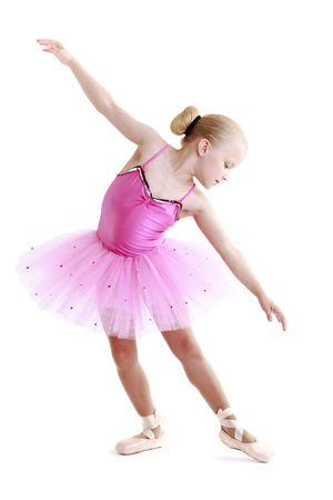 dancing pose: Young ballerina dancer over a white background