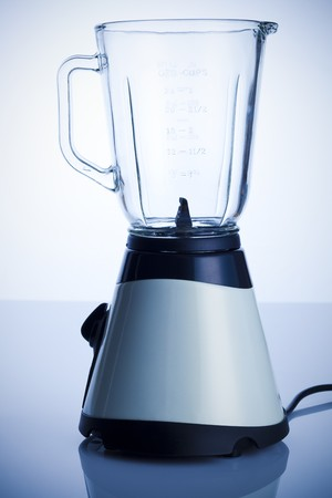 Empty blender on the kitchen table over white background