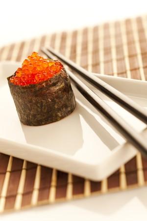 Salmon roe  seaweed sushi roll on the bamboo table Stock Photo