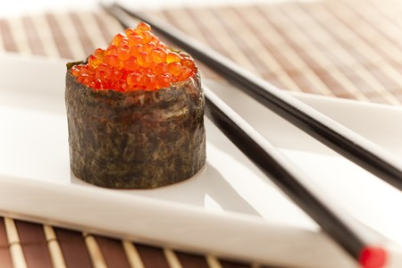 roe: Salmon roe  seaweed sushi roll on the bamboo table Stock Photo