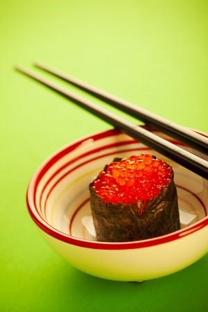 Salmon roe  seaweed sushi roll on the green table photo