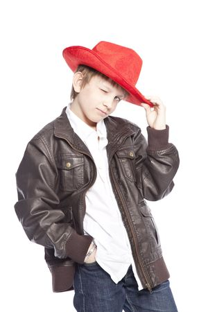 isolated boy wearing a cowboy hat over white background Stock Photo