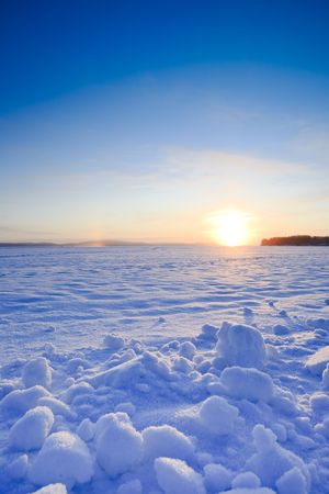 winter finland: Sunrise at cold morning on the lake in Finland Stock Photo
