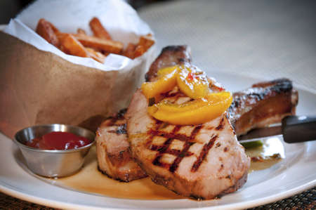 Smoked grilled pork chops with sweet potato fries