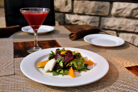 Beet salad with arugula, orange, roasted beets and goat cheese mousse with Beet Vodka Martini