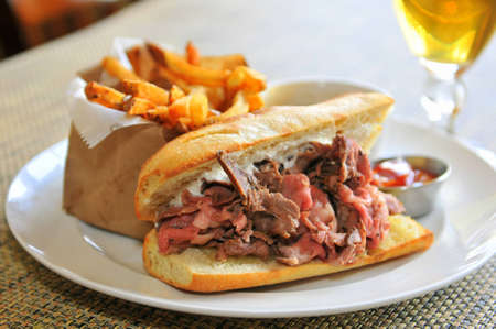 prime rib: French Dip Sandwich - Juicy smoked prime rib sandwich on a crunchy French baguette smeared with horseradish sauce, and thinly sliced medium rare prime rib and Swiss cheese