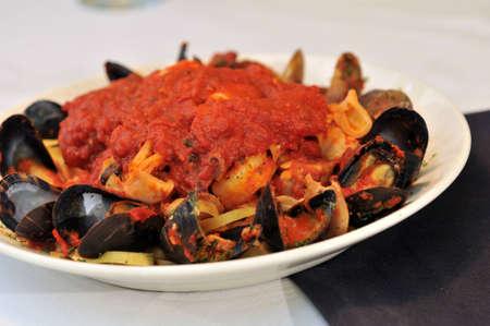 Seafood Fettuccine – Fettuccine pasta, sauce, fresh calamari, mussels, shrimp and clams