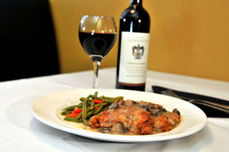 Chicken Romano seasoned with a blend of Italian cheeses then pan sautéed and baked in a mushroom wine sauce  Imagens