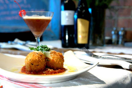 Stuffed Risotto Balls - Risotto balls, fried golden brown with a spicy tomato sauce and cocktail  Imagens