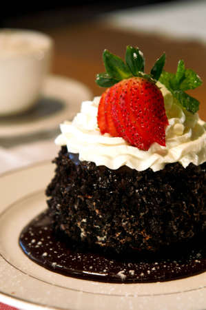 Delicate chocolate cake with whipped cream and strawberry