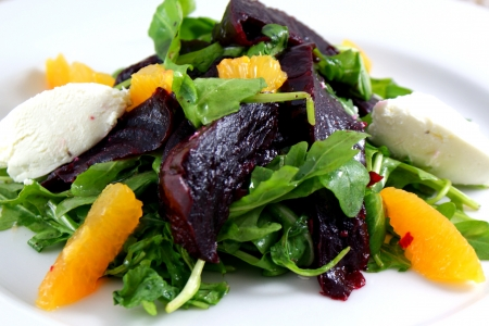 Beet salad with arugula, orange, roasted beets and goat cheese mousse