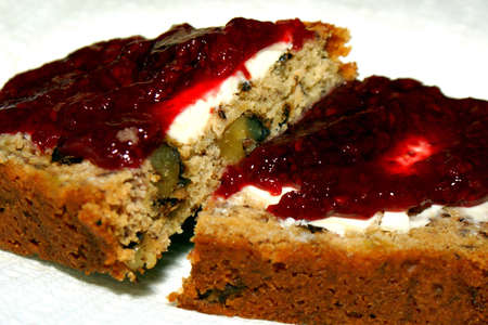 Banana bread with cream cheese and raspberry topping