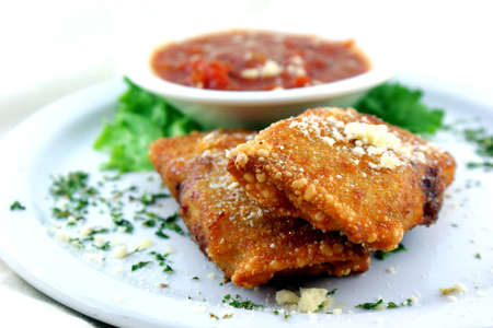 Fried Appetizer - Crumbled Italian sausage combined with three-cheese mixture then wrapped in egg rolls and fried to a crispy texture