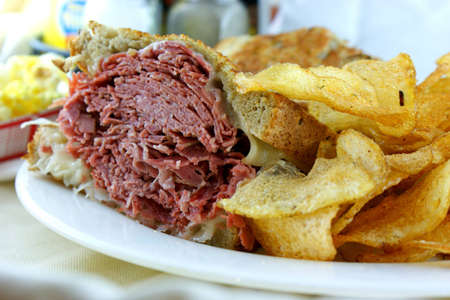 Corned Beef Rueben Sandwich - Fresh corned beef on grilled Rye with melted Swiss and sauerkraut