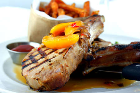 Smoked Grilled Pork Chops - Smoked grilled pork chops with sweet potato fries