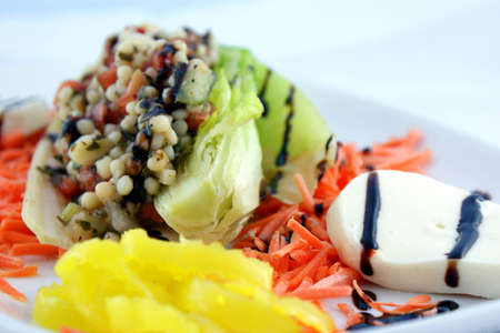 Couscous Salad - Romaine lettuce, cooked couscous, tomato, basil, fresh Mozzarella cheese with Balsamic and banana peppers