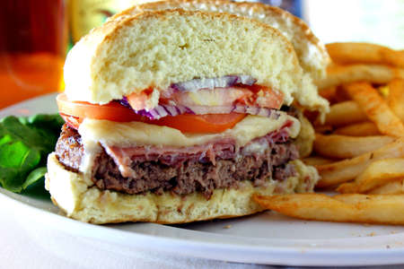 Prosciutto Burger - Prosciutto, beef burger, ham, mozzarella cheese, red onion and tomatoes with fries